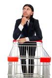 Achats d'homme avec le chariot de panier de supermarché Photo libre de droits