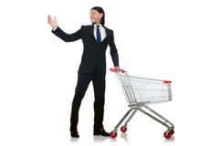 Achats d'homme avec le chariot de panier de supermarché d'isolement Image stock