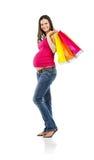 Achats de femme enceinte d'isolement sur le blanc Images libres de droits
