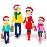 Achats de Noël de famille Image stock