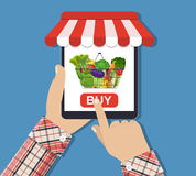 Achats de nourriture en ligne, smartphone Photographie stock