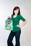 achats rouges d'une chevelure de fille de sac de l'adolescence Photographie stock libre de droits