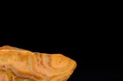 Achatstein mit schwarzem Hintergrund Stockfotografie