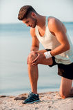 Ache in knee after running. Stock Image