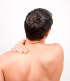 Ache man. Man with back neck ache Royalty Free Stock Photo