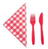 Acheckered napkin with plastic cutlery Royalty Free Stock Image