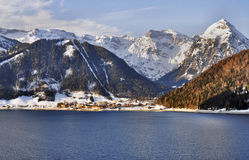Achensee lake in Austrian Alps. Achensee lake and Pertisau village in Austrian Alps in sunrise light royalty free stock photo