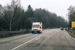 Deutsches Rotes Kreuz ambulance on a rainy day Royalty Free Stock Photo
