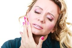 Woman with toothache problem. Aches and pains concept. Woman having bad ache and pain. Female feel tooth ache touching her mouth from oute by hand palm. Isolated royalty free stock photos