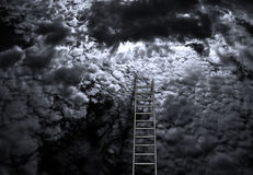 Achieve. Ladder rests in muted sky Stock Image