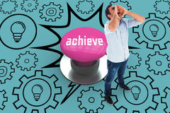 Achieve against pink push button Stock Images