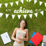 Achieve against pretty student lying on grass Royalty Free Stock Photo