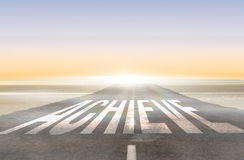 Achieve against road leading out to the horizon Royalty Free Stock Image