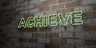 ACHIEVE - Glowing Neon Sign on stonework wall - 3D rendered royalty free stock illustration Stock Photography