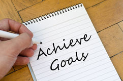 Achieve goals concept on notebook Stock Image