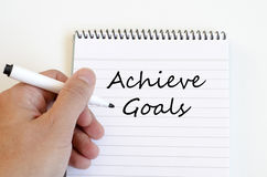 Achieve goals concept on notebook Royalty Free Stock Photo