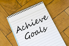 Achieve goals concept on notebook Stock Photos