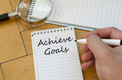 Achieve goals concept on notebook Royalty Free Stock Image