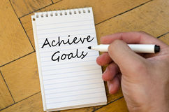 Achieve goals concept on notebook Royalty Free Stock Photography