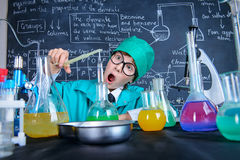 Achieve good results. Smart boy scientist making chemical experiments in the laboratory. Educational concept. Discovery Stock Image