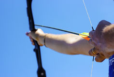 Achieve the objectives. Arrow that shoots into the sky Royalty Free Stock Image