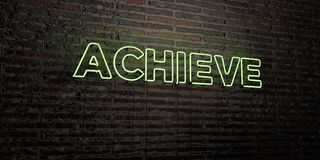 ACHIEVE -Realistic Neon Sign on Brick Wall background - 3D rendered royalty free stock image Stock Photo
