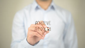 Achieve Results, Man writing on transparent screen Stock Photography