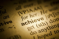 Achieve. Word Achieve in a dictionary Royalty Free Stock Image