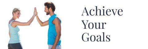 Achieve your goals text and couple giving high five. Digital composite of Achieve your goals text and couple giving high five royalty free stock images