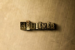 ACHIEVED - close-up of grungy vintage typeset word on metal backdrop Royalty Free Stock Photo