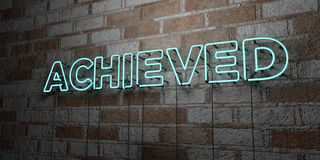 ACHIEVED - Glowing Neon Sign on stonework wall - 3D rendered royalty free stock illustration Royalty Free Stock Photography