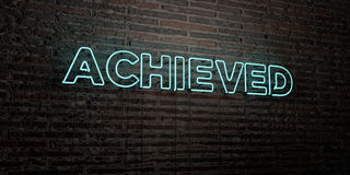 ACHIEVED -Realistic Neon Sign on Brick Wall background - 3D rendered royalty free stock image Stock Image
