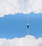 Achievement in business. Businessman standing on ladder high in sky Stock Images