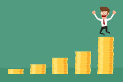 Achievement business man is happy on money stack graph. Stock Photo