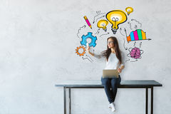 Achievement concept. Young woman sitting on table with laptop and taking selfie with smartphone. Concrete background with colorful business sketch. Achievement royalty free stock photos