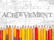 Achievement Pencils Sign. Achievement hand drawn sign and line of old pencils Stock Photos