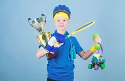 Achievement is its own reward. award ceremony. Happy child sportsman hold champion cup. Sport and health. Fitness and. Diet. Energy. success. Childhood activity stock photography