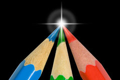 Achievement of the purpose. Three sharp color pencils (on a black background Vector Illustration
