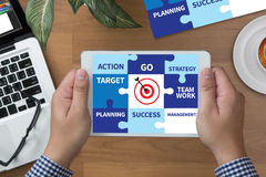 Achievement Success Goals and success and team work Jigsaw Puzz. Le to Target royalty free stock photography