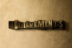 ACHIEVEMENTS - close-up of grungy vintage typeset word on metal backdrop. Royalty free stock illustration. Can be used for online banner ads and direct mail vector illustration