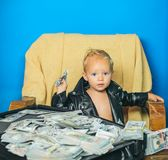 Achieving best results. Small child do business accounting in startup company. Startup business costs. Little. Entrepreneur work in office. Boy child with money royalty free stock photography