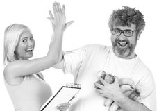 Achieving a diet goal. Mid age men gets high five from personal trainer stock photography