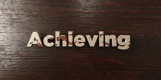 Achieving - grungy wooden headline on Maple  - 3D rendered royalty free stock image Royalty Free Stock Photos