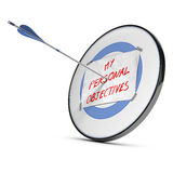 Achieving Personal Objectives or Goals. One arrow hits the center of a target with a sheet of paper with my personal objectives handwritten on it, red, blue and Royalty Free Stock Photos