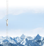 Achieving the top. Businesswoman standing on ladder high above mountains Royalty Free Stock Photography