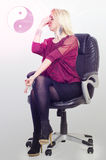 Achieving zen at work, woman looking for creativity at work in office Royalty Free Stock Image