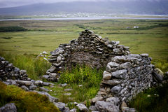 Achill island deserted village in fog. Deserted village on Achill Island. The Deserted Village at Slievemore consists of some 80 - 100 stone cottages located Royalty Free Stock Photography