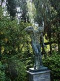 Statue in the Garden of the Achillieon Palace on the island of Corfu Greece built by Empress Elizabeth of Austria Sissi. Achilleion is a palace built in Corfu by stock photo