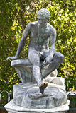 Achilleion palace, Corfu, Greece. Ancient greek statue in middle of a garden Royalty Free Stock Image
