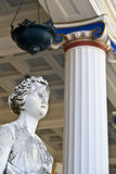 Achilleion palace, Corfu, Greece. Greek classic era statue standing in front of a temple Royalty Free Stock Photography